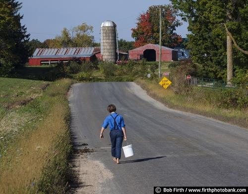 Amish boy, walking to school, country, Wisconsin, WI, farm, agricultural scene, child, barefoot, lunch pail, road,barn