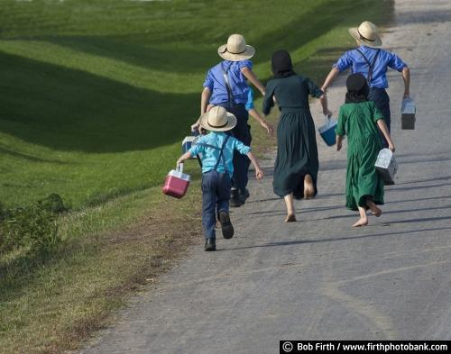 Amish children,walking home from school, WI, Wisconsin, agricultural scene, agriculture, barefoot, bare feet, country, road, boys, girls, playful,lunch pail