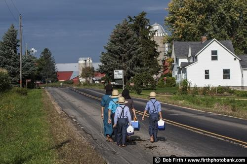 Amish children, walking to school, barefoot, lunch pail, road, Wisconsin,WI, country,farm,barn,fall,agricultural scene, agriculture;Amish home; Amish homestead, Amish house,boy,girl,bare feet,lunch pail