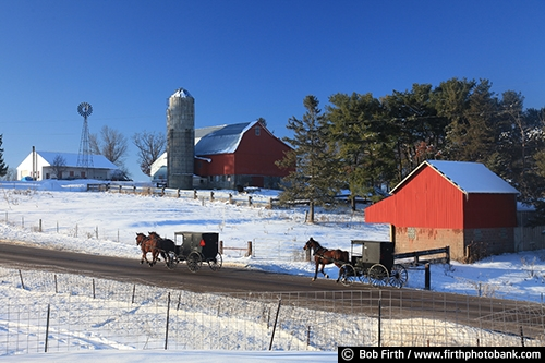 Wisconsin;winter;windmill;WI;road;red barn;horse drawn carriage;homestead;farm;country;carriage;buggy;barn;Amish;agriculture;agricultural scene;field;snow;silo