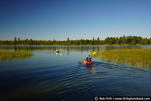 Itasca State Park;Lake Itasca;Headwaters;Mississippi River;boating;boat;kayaking;kayaker;destination;explore;man;MN;northern Minnesota;paddle sport;pine trees;quiet water;summer;tourism;tourist;transportation;travel;up north;upper Mississippi River;woman
