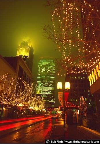 Nicollet Mall,Mpls,Minneapolis,MN,Minnesota,Christmas lights,decorations,night,buildings,IDS,Wells Fargo Center,city street scene,fog,nighttime,winter