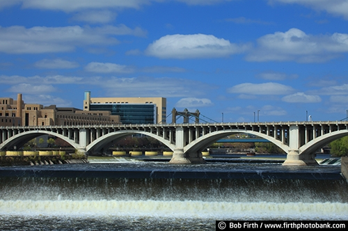 blue sky;buildings;Central Avenue Bridge;clouds;dam;daytime;Federal Reserve Bank;JJ Hill Bridge;Minneapolis;Minnesota;Mississippi River;MN;Mpls;Third Avenue Bridge;water;Twin Cities