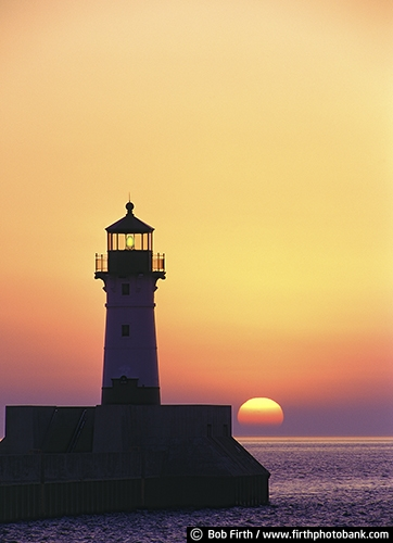 tourism;sun;silhouettes;orange sky;northern Minnesota;North Shore lighthouses;MN;Lake Superior Water Trail;Kitchi Gammi;destination;Duluth Lighthouse;sunrise;beacon