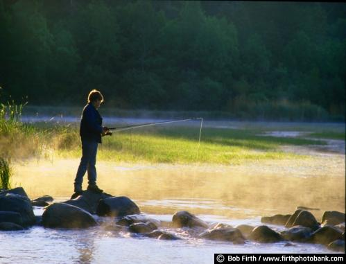 Minnesota;Minnesota State Parks;Itasca State Park;fishing;boy fishing;boy;Mississippi River Headwaters;misty;dawn;sunrises;fishing from rocks;summer;MN