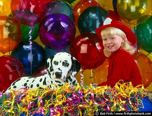 boy;Dalmation;dog;celebration;animal;balloons;black spots;child;companion;companionship;confetti;firemans hat;friends;friendship;fun;adorable;pet;purebred;portrait