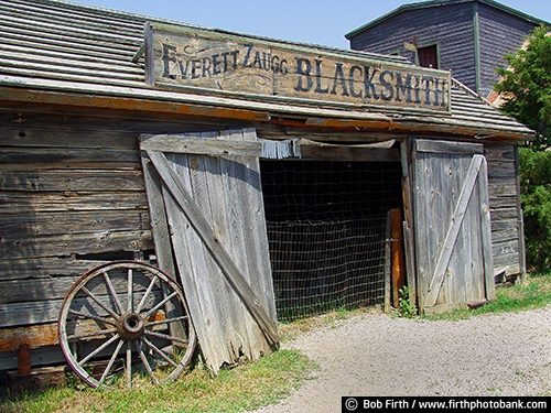 1880 Ghost Town;Midland SD;old building;South Dakota;weathering;weathered;tourism;country;destination;rural;blacksmith shop;advertising;business sign;store ;wagon wheel