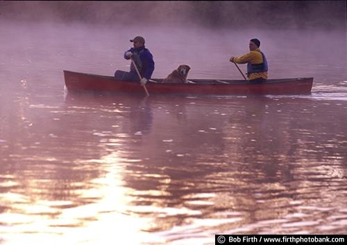 canoe;canoeing;companionship;dog;fog;foggy;fun pastime;lake;men;Minnesota;MN;paddle sport;peaceful;recreational;water sport;morning;sunrise