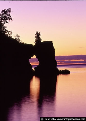 Lake Superior;Kitchi Gammi;largest freshwater lake;Minnesotas North Shore;MN;northern Minnesota;peaceful;shoreline;tourism;water;destination;biggest fresh water lake;Arch Rock;calm water;dramatic sky;Great Lakes;large rock formation;moody;pink;silhouettes;sunset;sunrise;Tettegouche State Park;twilight
