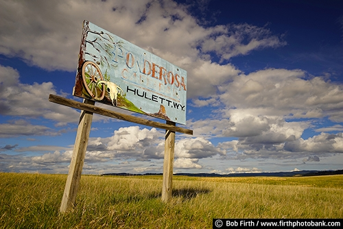 South Dakota;Black Hills;SD;sign;old sign;signage;skull;wagonwheel;wagon wheel;Ponderosa;low angle view;advertising;destination;fading paint;hand painted
